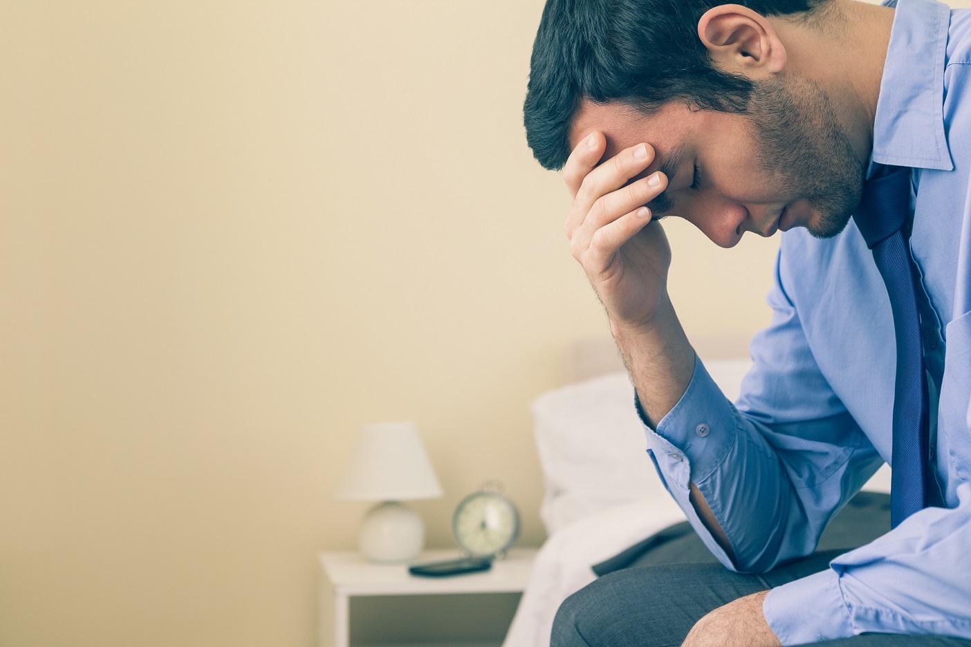 Męska twarz depresji